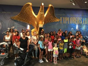 Mothers and their children on a field trip at the The Mariners' Museum and Park.