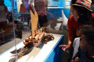 A mommy showing children a ship model at The Mariners' Museum.