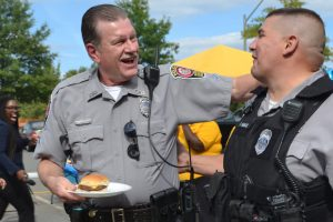 Police officers sharing laughs together during the Police Appreciation Cookout.